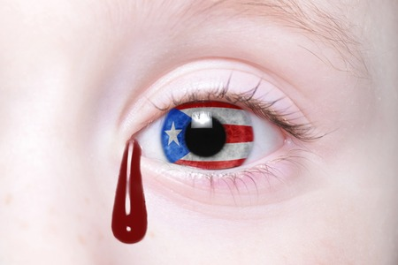54395564 - human's eye with national flag of puerto rico with bloody tears